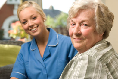 image of elderly woman with health care assistant